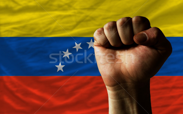 Hard fist in front of venezuela flag symbolizing power Stock photo © vepar5