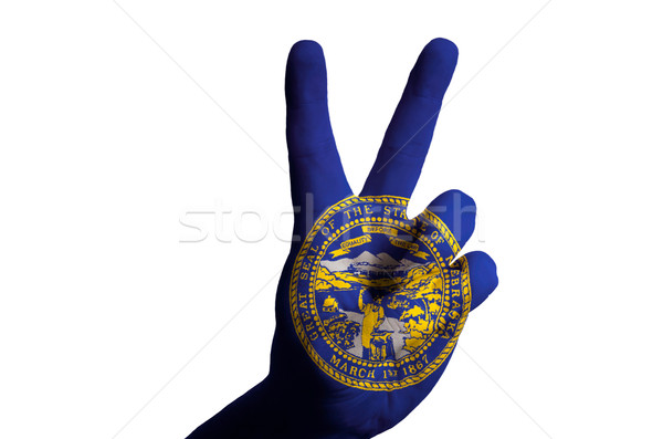 nebraska us state flag two finger up gesture for victory and win Stock photo © vepar5