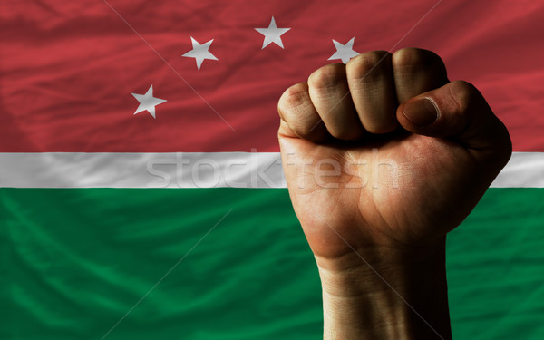 Hard fist in front of maghreb flag symbolizing power Stock photo © vepar5