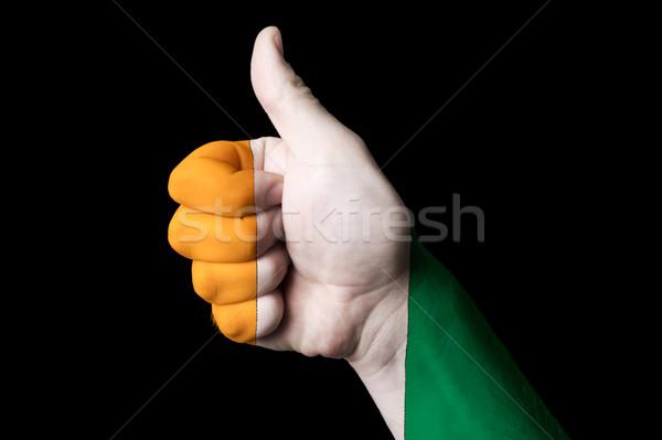 Elefántcsontpart zászló hüvelykujj felfelé kézmozdulat kiválóság Stock fotó © vepar5