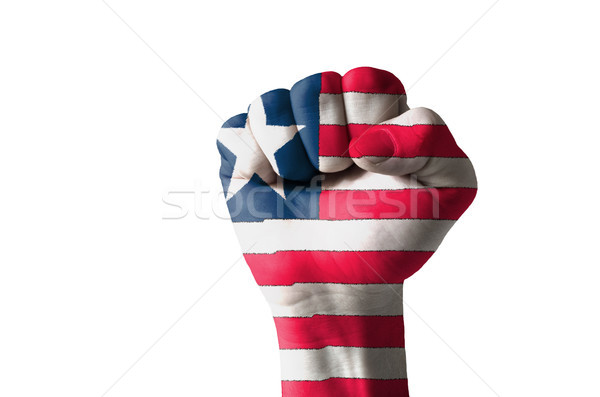 Fist painted in colors of liberia flag Stock photo © vepar5