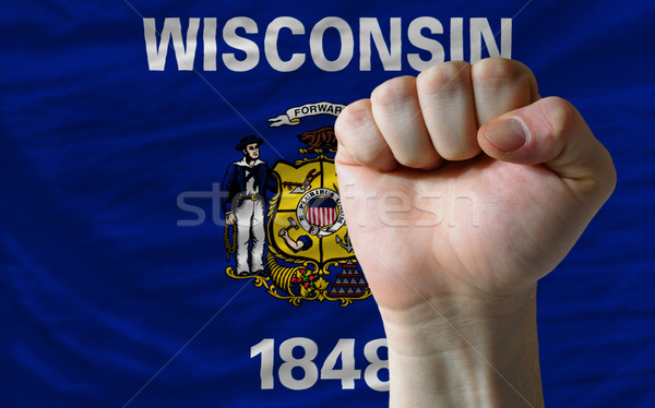 us state flag of wisconsin with hard fist in front of it symboli Stock photo © vepar5