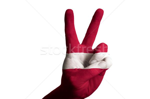 Letland vlag twee vinger omhoog gebaar Stockfoto © vepar5