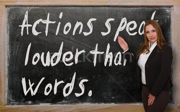 Teacher showing Actions speak louder than words on blackboard Stock photo © vepar5