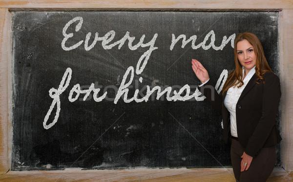 Teacher showing Every man for himself on blackboard Stock photo © vepar5