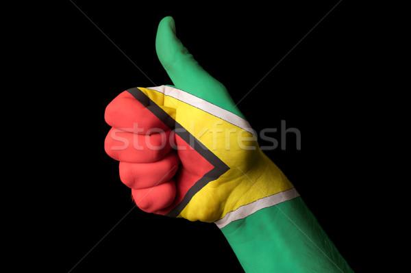 Guyana zászló hüvelykujj felfelé kézmozdulat kiválóság Stock fotó © vepar5