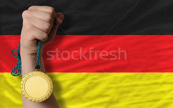 Gold medal for sport and  national flag of germany    Stock photo © vepar5