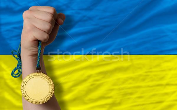 Gold medal for sport and  national flag of ukraine    Stock photo © vepar5