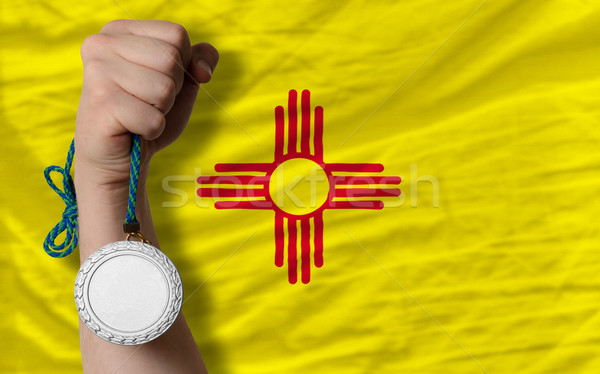 Silver medal for sport and  flag of american state of new mexico Stock photo © vepar5