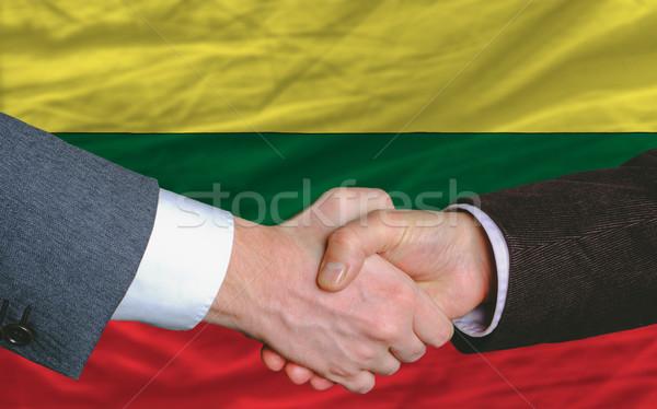 businessmen handshake after good deal in front of lithuania flag Stock photo © vepar5