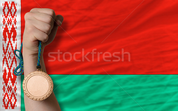 Stock photo: Bronze medal for sport and  national flag of belarus