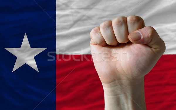 us state flag of texas with hard fist in front of it symbolizing Stock photo © vepar5