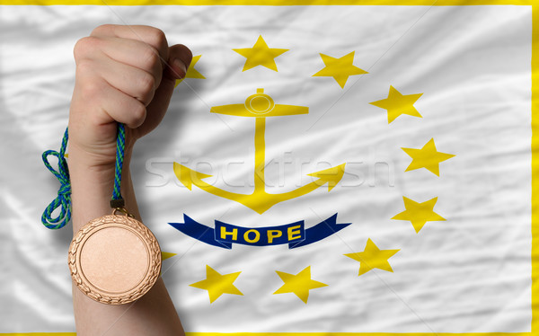 Bronze medal for sport and  flag of american state of rhode isla Stock photo © vepar5