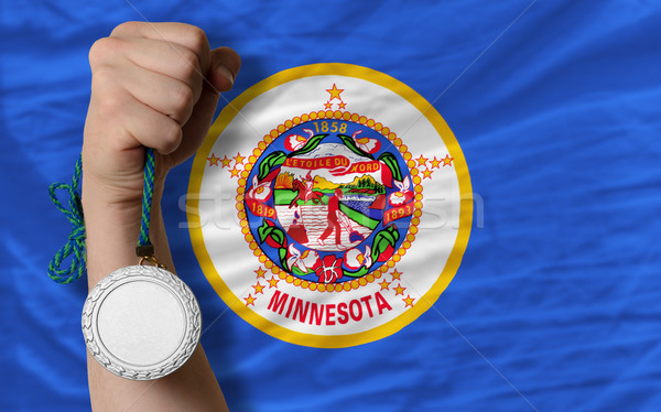 Silver medal for sport and  flag of american state of minnesota  Stock photo © vepar5