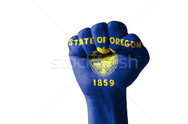 Stock photo: Fist painted in colors of us state of oregon flag