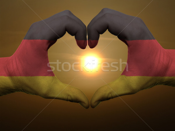 Heart and love gesture by hands colored in germany flag during b Stock photo © vepar5