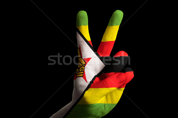 zimbabwe national flag two finger up gesture for victory and win Stock photo © vepar5