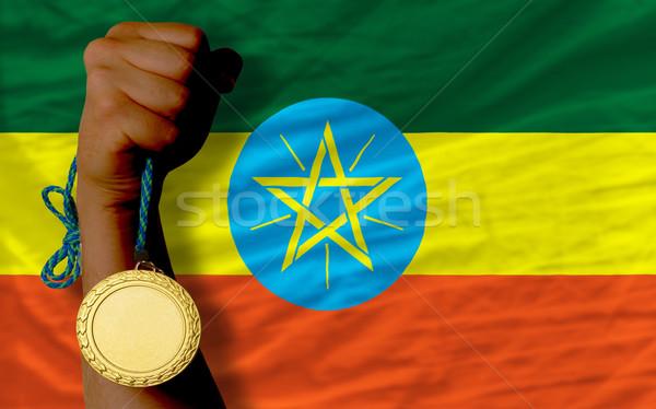 Złoty medal sportu banderą Etiopia zwycięzca Zdjęcia stock © vepar5