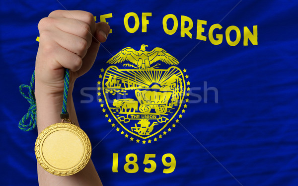Gold medal for sport and  flag of american state of oregon    Stock photo © vepar5