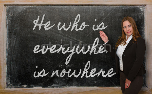 Teacher showing He who is everywhere is nowhere on blackboard Stock photo © vepar5