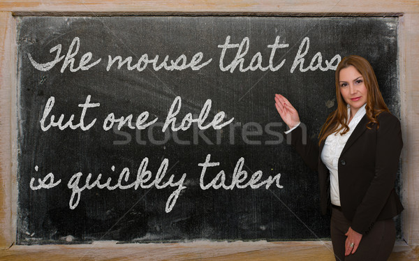 Teacher showing The mouse that has but one hole is quickly taken Stock photo © vepar5