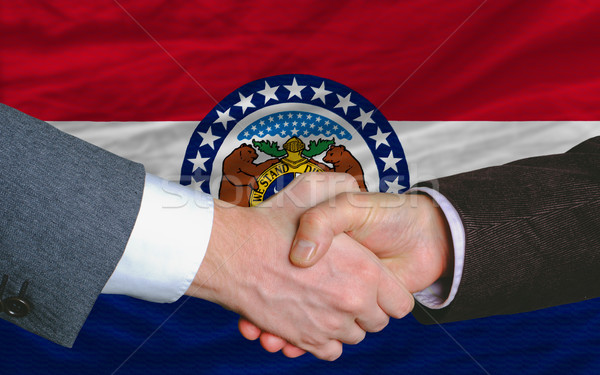 in front of american state flag of missouri two businessmen hand Stock photo © vepar5