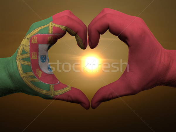 Heart and love gesture by hands colored in portugal flag during  Stock photo © vepar5