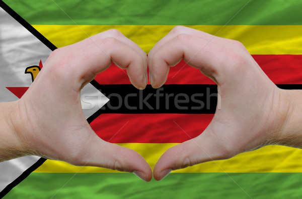 Heart and love gesture showed by hands over flag of zimbabwe bac Stock photo © vepar5