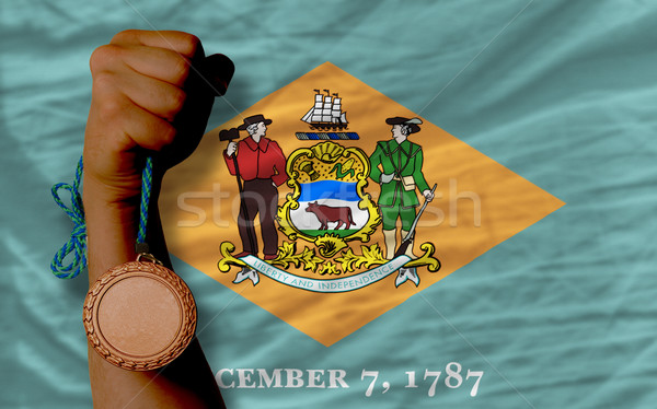 Bronze medal for sport and  flag of american state of delaware   Stock photo © vepar5