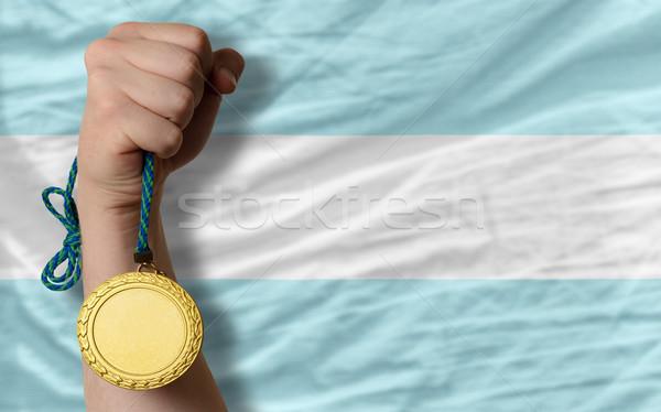 Médaille d'or sport pavillon Argentine gagnant Photo stock © vepar5