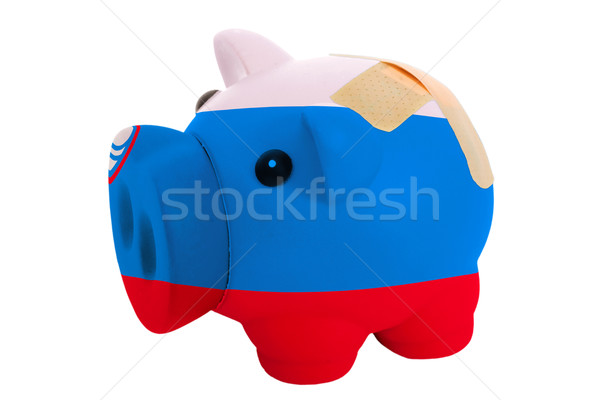 closed piggy rich bank with bandage in colors national flag of s Stock photo © vepar5