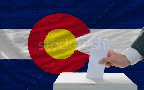 man voting on elections in front of flag US state flag of colora Stock photo © vepar5