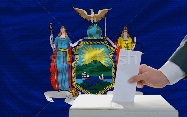 man voting on elections in front of flag US state flag of new yo Stock photo © vepar5