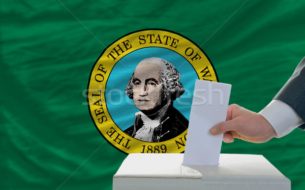man voting on elections in front of flag US state flag of west w Stock photo © vepar5