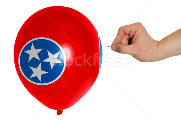 Bursting balloon colored in  flag of american state of tennessee Stock photo © vepar5