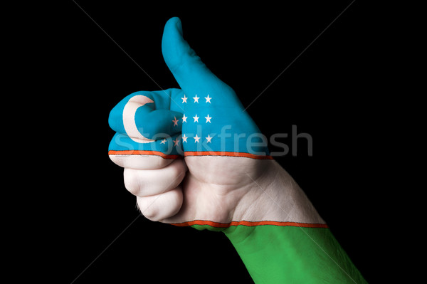 uzbekistan national flag thumb up gesture for excellence and ach Stock photo © vepar5