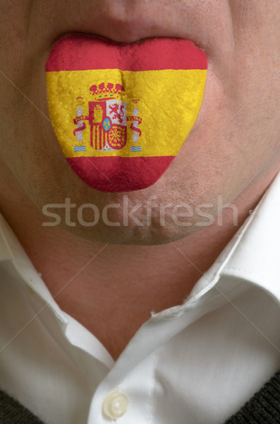 man tongue painted in spain flag symbolizing to knowledge to spe Stock photo © vepar5