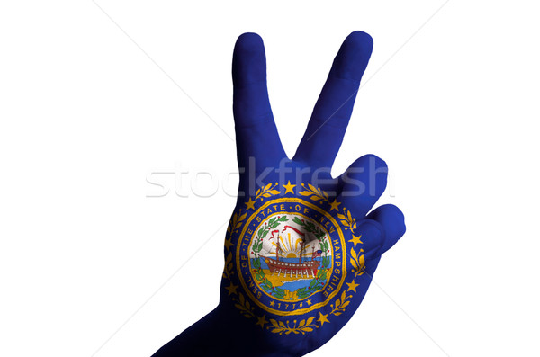 new hampshire us state flag two finger up gesture for victory an Stock photo © vepar5