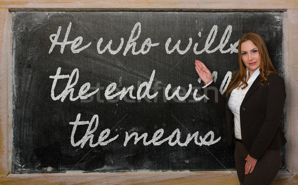 Teacher showing He who wills the end wills  the means on blackbo Stock photo © vepar5