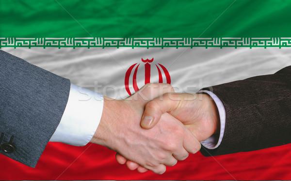 businessmen handshake after good deal in front of iran flag Stock photo © vepar5