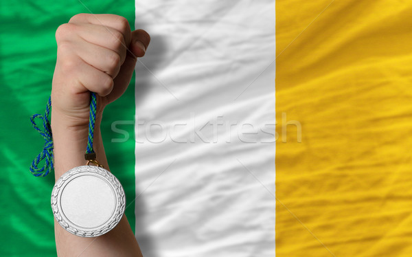 Stock photo: Silver medal for sport and  national flag of ireland