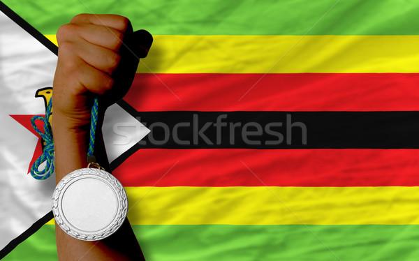 Argento medaglia sport bandiera Zimbabwe Foto d'archivio © vepar5