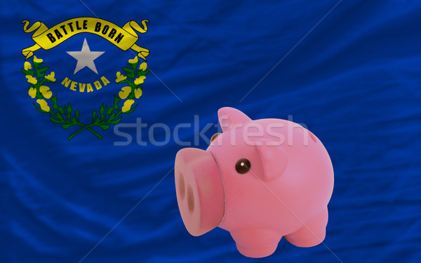piggy rich bank and  flag of american state of nevada    Stock photo © vepar5