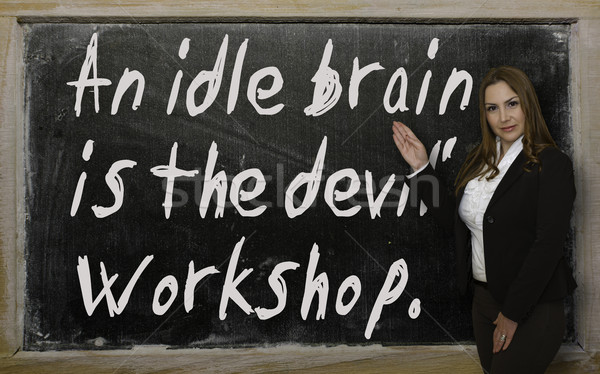 Teacher showing An idle brain is the devil's workshop on blackbo Stock photo © vepar5