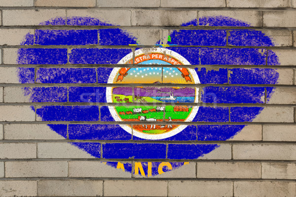 Stock photo: heart shape flag of kansas on brick wall