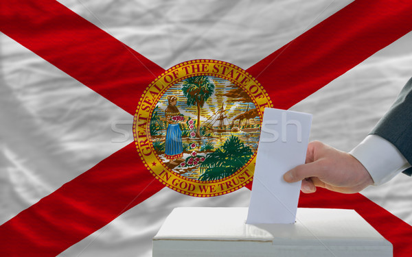 man voting on elections in front of flag US state flag of florid Stock photo © vepar5