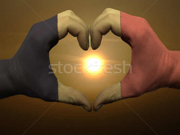 Heart and love gesture by hands colored in belgium flag during b Stock photo © vepar5