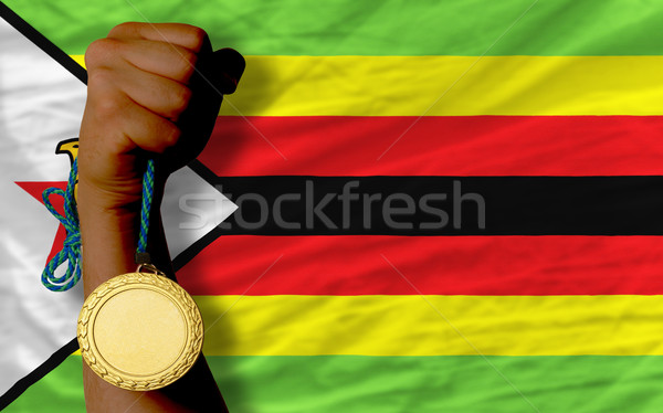 Gold medal for sport and  national flag of zimbabwe    Stock photo © vepar5