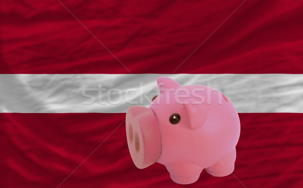 piggy rich bank and  national flag of latvia    Stock photo © vepar5