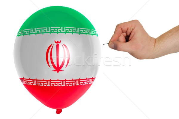 Stock photo: Bursting balloon colored in  national flag of iran